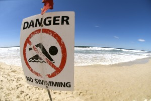 stock-photo-10609063-lifeguard-flag-and-warning