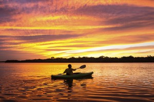 stock-photo-40517686-woman-kayaking-at-sunset