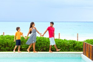 stock-photo-46025474-playful-family-walking-next-to-pool