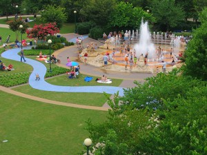 Aerial view of green public park in Chattanooga, Tennessee with children playing in fountain