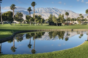 The San Jacinto Mountains reflect off the water on a Palm Springs California golf course.