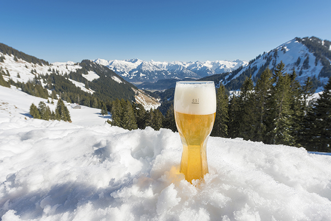 Bavarian wheat beer in winter landscape