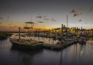 """Boats are docked for the night at Captain Dicks Marina in Murrells Inlet, South Carolina"""