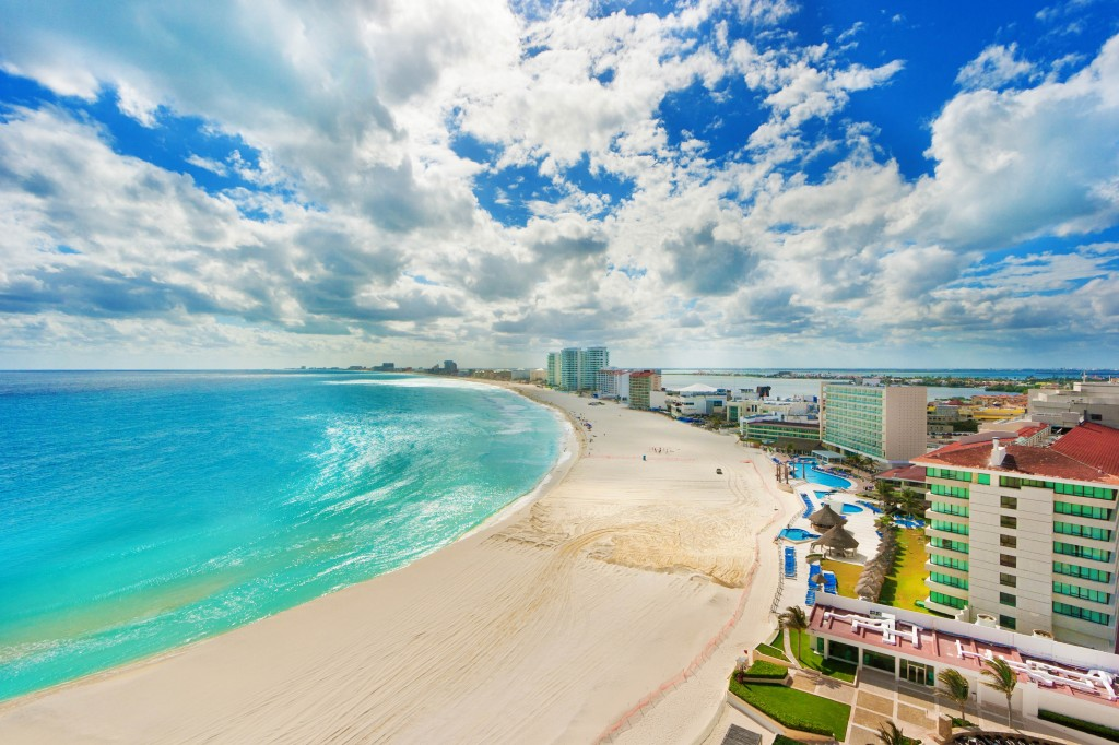 Subject: The beach and resort hotel district of Cancun, Mexico. with numerous hotels, resorts and entertainment establishments, the resort district of Cancun is a popular tourist destination in the Caribbean Sea.