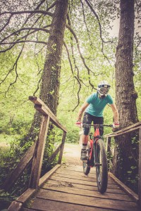 Enduro All Mountain E bike rider - adrenaline MTB woods trail