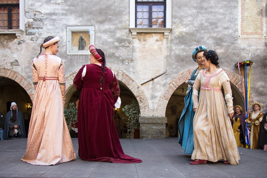 Medieval Lady dancing on castle Yard on historical reenactment in Gorizia, Italy