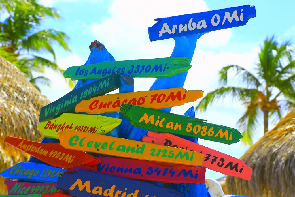 Colorful distances to various locations around the world, Aruba